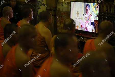 Thai Buddhist Monks Watch Television During the Accession to the Throne Proclamation Ceremony of the New King Maha Vajiralongkorn Bodindradebayavarangkun As They Gather For a Prayer Ceremony on the Occasion at Wat Benchamabophit Dusitvanaram Also Known As the Marble Temple in Bangkok Thailand 01 December 2016 Thailand Has New King After Crown Prince Maha Vajiralongkorn 64 Accepted to Ascend the Throne to Become the Country's New Monarch the 10th King of the 234-year-old Chakri Dynasty the King Maha Vajiralongkorn Bodindradebayavarangkun Succeeds His Late Father Thai King Bhumibol Adulyadej the World's Longest Reigning Monarch who Died at the Age of 88 in Siriraj Hospital on 13 October 2016 Thailand Bangkok