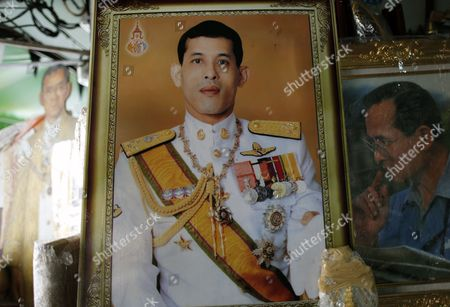A Framed Photograph of Thai Crown Prince Maha Vajiralongkorn is Displayed at a Shop in Bangkok Thailand 29 November 2016 Thailand's National Legislative Assembly (nla) Invited Crown Prince Maha Vajiralongkorn 64 to Become the Country's New Monarch the 10th King of the Chakri Dynasty on 29 November 2016 the Prince is Due to Succeed His Father Late Thai King Bhumibol Adulyadej the World's Longest Reigning Monarch who Died at the Age of 88 in Siriraj Hospital on 13 October 2016 Thailand Bangkok