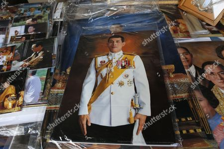 Photographs of Thai Crown Prince Maha Vajiralongkorn Are Displayed at a Shop in Bangkok Thailand 29 November 2016 Thailand's National Legislative Assembly (nla) Invited Crown Prince Maha Vajiralongkorn 64 to Become the Country's New Monarch the 10th King of the Chakri Dynasty on 29 November 2016 the Prince is Due to Succeed His Father Late Thai King Bhumibol Adulyadej the World's Longest Reigning Monarch who Died at the Age of 88 in Siriraj Hospital on 13 October 2016 Thailand Bangkok