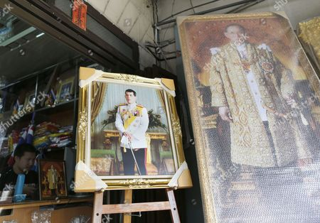 Framed Photographs of Thai Crown Prince Maha Vajiralongkorn (l) and Late Thai King Bhumibol Adulyadej (r) Are Displayed at a Royal Authorized Memorabilia Shop in Bangkok Thailand 29 November 2016 Thailand's National Legislative Assembly (nla) Invited Crown Prince Maha Vajiralongkorn 64 to Become the Country's New Monarch the 10th King of the Chakri Dynasty on 29 November 2016 the Prince is Due to Succeed His Father Late Thai King Bhumibol Adulyadej the World's Longest Reigning Monarch who Died at the Age of 88 in Siriraj Hospital on 13 October 2016 Thailand Bangkok