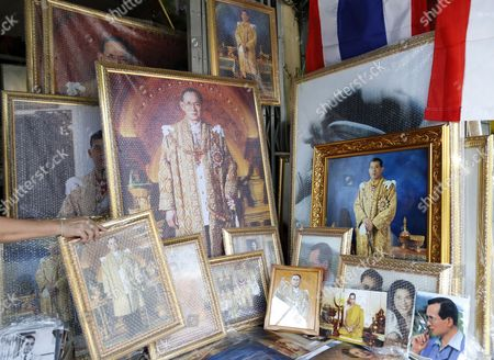 A Framed Photograph of Thai Crown Prince Maha Vajiralongkorn (r) is Displayed Among Portraits of Late Thai King Bhumibol Adulyadej at a Shop in Bangkok Thailand 29 November 2016 Thailand's National Legislative Assembly (nla) Invited Crown Prince Maha Vajiralongkorn 64 to Become the Country's New Monarch the 10th King of the Chakri Dynasty on 29 November 2016 the Prince is Due to Succeed His Father Late Thai King Bhumibol Adulyadej the World's Longest Reigning Monarch who Died at the Age of 88 in Siriraj Hospital on 13 October 2016 Thailand Bangkok