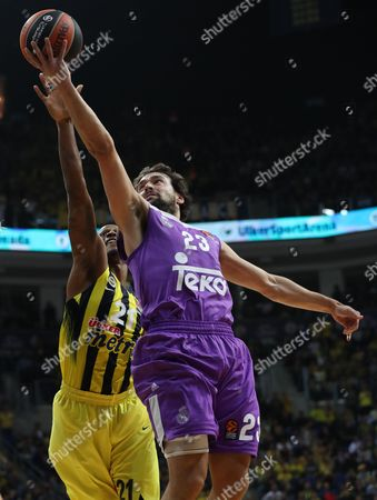 Real Madrid's Sergio Llull (r) Tries to Score Under Defense of Fenerbahce's James Nunnally (r) During the Euroleague Basketball Match Between Fenerbahce and Real Madrid in Istanbul Turkey 01 December 2016 Turkey Istanbul