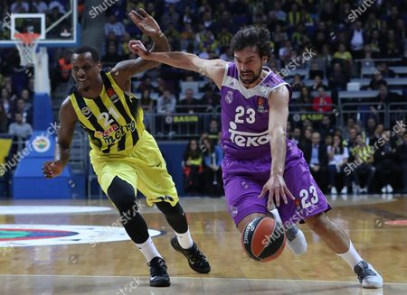 Real Madrid's Sergio Llull (r) Tries to Score Under Defense of Fenerbahce's James Nunnally (l) During the Euroleague Basketball Match Between Fenerbahce and Real Madrid in Istanbul Turkey 01 December 2016 Turkey Istanbul