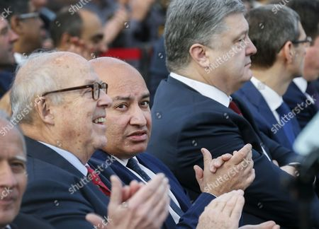 Stock Picture of (l-r) Chairman of Chernobyl Shelter Fund Hans Blix President of the European Bank For Reconstruction and Development (ebrd) Sir Suma Chakrabarti and President of Ukraine Petro Poroshenko Applaud During the Opening Ceremony of a New Protective Shelter Which is Placed Over the Remains of the Nuclear Reactor Unit 4 at Chernobyl Nuclear Power Plant in Chernobyl Ukraine 29 November 2016 the Explosion of Unit 4 of the Chernobyl Nuclear Power Plant in the Early Hours of 26 April 1986 is Still Regarded the Biggest Accident in the History of Nuclear Power Generation Under Extremely Hazardous Conditions a Steel and Concrete Structure was Built Hastily Immediately After the Accident the New Concrete and Steel Built Over the Still-radioactive Remains of a Reactor Which was Melted Down As a Result of the Accident and Has 105 Meters Tall 150 Meters Length with a Width of 257 Meters and a 100 Years Life Expectancy of the Confinement Ukraine Chernobyl
