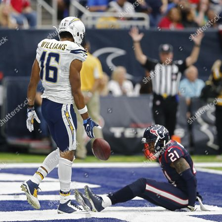San Diego Chargers Player Tyrell Williams (l) Drops the Football in Front of Houston Texans Player a J Bouye (r) After Scoring a Touchdown Against Him in the First Half of Their Nfl Game at Nrg Stadium in Houston Texas Usa 27 November 2016 United States Houston