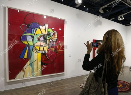 An Art Patron Takes Photographs of 'Figure on Red Field' by Us Artist George Condo at Art Basel in Miami Florida Usa 30 November 2016 Art Basel Represents Over 250 Art Galleries Onsite at the Miami Beach Convention Center and is Considered One of the World's Largest Art Festivals with Art Events Throughout the City United States Miami