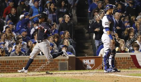 Cleveland Indians Baserunner Michael Martinez (l) Scores Behind Chicago Cubs Catcher Willson Contreras (r) on an Rbi Single by Pinch Hitter Coco Crisp in the Top of the Seventh Inning of Game Three of the World Series Between the Chicago Cubs and the Cleveland Indians at Wrigley Field in Chicago Illinois Usa 28 October 2016 the Best-of-seven Series is Tied 1-1 and Games Three Four and Five Will Be Played in Chicago Before Returning to Cleveland For Games Six and Seven if Necessary United States Chicago
