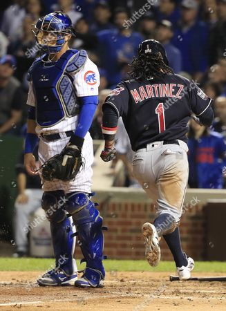 Cleveland Indians Baserunner Michael Martinez (r) Scores Behind Chicago Cubs Catcher Willson Contreras (l) on an Rbi Single by Pinch Hitter Coco Crisp in the Top of the Seventh Inning of Game Three of the World Series Between the Chicago Cubs and the Cleveland Indians at Wrigley Field in Chicago Illinois Usa 28 October 2016 the Best-of-seven Series is Tied 1-1 and Games Three Four and Five Will Be Played in Chicago Before Returning to Cleveland For Games Six and Seven if Necessary United States Chicago