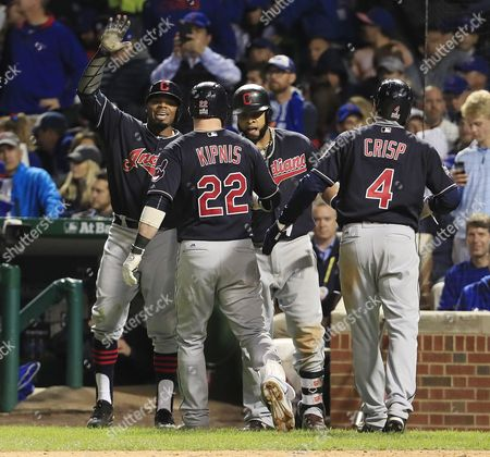 Cleveland Indians (l-r) Rajai Davis Jason Kipnis Carlos Santana and Coco Crisp Celebrate After Kipnis Hit a Three-run Home Run in the Top of the Seventh Inning of Game Four of the World Series Between the Chicago Cubs and the Cleveland Indians at Wrigley Field in Chicago Illinois Usa 29 October 2016 the Indians Lead the Best-of-seven Series 2-1 and Games Four and Five Will Be Played in Chicago Before Returning to Cleveland For Games Six and Seven if Necessary United States Chicago