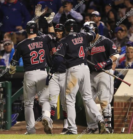 Cleveland Indians (l-r) Jason Kipnis Rajai Davis Coco Crisp and Carlos Santana Celebrate After Kipnis Hit a Three-run Home Run in the Top of the Seventh Inning of Game Four of the World Series Between the Chicago Cubs and the Cleveland Indians at Wrigley Field in Chicago Illinois Usa 29 October 2016 the Indians Lead the Best-of-seven Series 2-1 and Games Four and Five Will Be Played in Chicago Before Returning to Cleveland For Games Six and Seven if Necessary United States Chicago