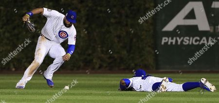 Chicago Cubs Right Fielder Jason Heyward (l) Picks Up a Double Off the Bat of Cleveland Indians Batter Coco Crisp That was Deflected by Center Fielder Dexter Fowler (r) in the Top of the Seventh Inning of Game Four of the World Series Between the Chicago Cubs and the Cleveland Indians at Wrigley Field in Chicago Illinois Usa 29 October 2016 the Indians Lead the Best-of-seven Series 2-1 and Games Four and Five Will Be Played in Chicago Before Returning to Cleveland For Games Six and Seven if Necessary United States Chicago