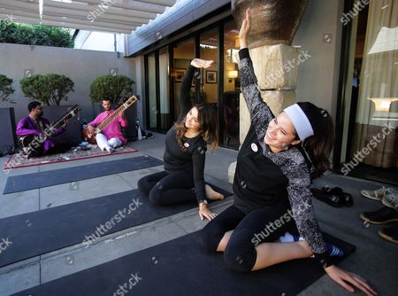 Voters Megan Gallagher (r) and Megan Monahan (c) Take Advantage of Free Yoga Lessons with Sitar Players at the Luxe Hotel Polling Station For the 2016 Us Presidential Election in Los Angeles California Usa 08 November 2016 Americans Vote on Election Day to Choose the 45th President of the United States of America to Serve From 2017 Through 2020 United States Los Angeles