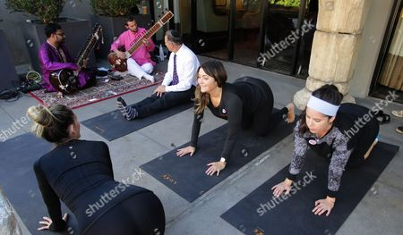 Stock Image of Voters Megan Gallagher (r) and Megan Monahan (2nd R) Take Advantage of Free Yoga Lessons by Instructor Rachel Jackson (l) with Sitar Players at the Luxe Hotel Polling Station For the 2016 Us Presidential Election in Los Angeles California Usa 08 November 2016 Americans Vote on Election Day to Choose the 45th President of the United States of America to Serve From 2017 Through 2020 United States Los Angeles
