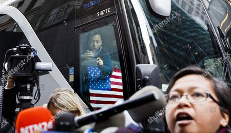 A Man on a Passing Tour Bus Takes a Picture of People Setting Up For a Press Conference with Green Party Presidential Candidate Jill Stein About the Ongoing Efforts She is Involved in to Recount Votes in Michigan Wisconsin and Pennsylvania Across the Street From Trump Tower in New York New York Usa 05 December 2016 United States New York