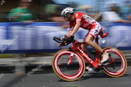 Stock Photo of Ben Hoffman of the Usa Races Around the 'Hot Corner' at the Intersection of Kuakini Highway and Palani Drive to Complete the Biking Leg of the Ironman World Championship Triathlon in Hawaii Usa 08 October 2016 United States Kailua-kona