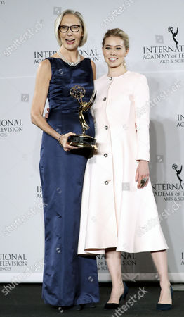 Maria Rorbye Ronn (l) the Ceo and Director General of the Danish Broadcasting Corporation Poses with the Directorate Award While Standing with Danish Actress Birgitte Hjort Sorensen (r) in the Press Room at the 44th International Emmy Awards in New York New York Usa 21 November 2016 United States New York