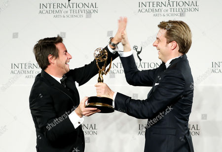 Stock Picture of German Director Matthias Bittner (l) and Producer Paul Zischler (r) Hold the International Emmy Award For Documentary For 'War of Lies' During the 44th International Emmy Awards in New York New York Usa 21 November 2016 United States New York