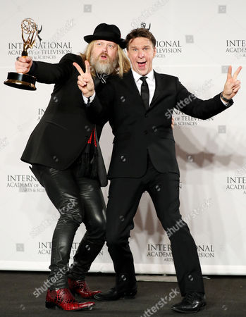 Stock Picture of Swedish Producer Christer Akerlund (l) and Swedish Television Host Anders Lundin (r) Pose with the International Emmy Award For Non-scripted Entertainment For 'The Great Swedish Adventure' During the 44th International Emmy Awards in New York New York Usa 21 November 2016 United States New York
