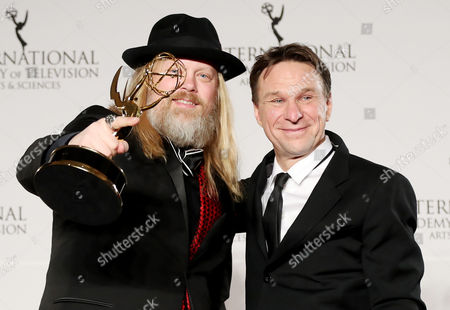 Stock Photo of Swedish Producer Christer Akerlund (l) and Swedish Television Host Anders Lundin (r) Pose with the International Emmy Award For Non-scripted Entertainment For 'The Great Swedish Adventure' During the 44th International Emmy Awards in New York New York Usa 21 November 2016 United States New York