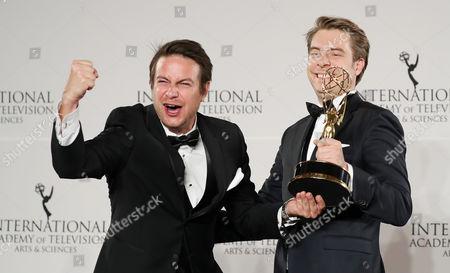Stock Image of German Director Matthias Bittner (l) and Producer Paul Zischler (r) Hold the International Emmy Award For Documentary For 'War of Lies' During the 44th International Emmy Awards in New York New York Usa 21 November 2016 United States New York