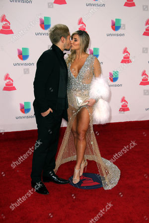 Jesús Alberto Miranda Perez of Chino (l) and Natasha Araos Arrive at the 17th Annual Latin Grammy Awards at the T-mobile Arena in Las Vegas Nevada Usa 17 November 2016 Latin Grammy Awards Recognize Artistic and Technical Achievement not Sales Figures Or Chart Positions and the Winners Are Determined by the Votes of Their Peers and Qualified Voting Members of the Academy United States Las Vegas