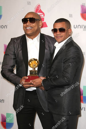 Alexander Delgado (l) and Randy Malcom Martinez of Gente De Zona Pose with Their Award For âbest Tropical Fushion Album ' in the Press Room During the 17th Annual Latin Grammy Awards at the T-mobile Arena in Las Vegas Nevada Usa 17 November 2016 Latin Grammy Awards Recognize Artistic and Technical Achievement not Sales Figures Or Chart Positions and the Winners Are Determined by the Votes of Their Peers and Qualified Voting Members of the Academy United States Las Vegas