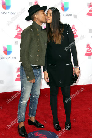 Pharrell Williams (l) and Helen Lasichanh Arrive at the 17th Annual Latin Grammy Awards at the T-mobile Arena in Las Vegas Nevada Usa 17 November 2016 Latin Grammy Awards Recognize Artistic and Technical Achievement not Sales Figures Or Chart Positions and the Winners Are Determined by the Votes of Their Peers and Qualified Voting Members of the Academy United States Las Vegas