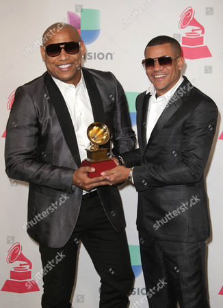 Alexander Delgado (l) and Randy Malcom Martinez of Gente De Zona Pose with Their Award For Best Tropical Fushion Album ' in the Press Room During the 17th Annual Latin Grammy Awards at the T-mobile Arena in Las Vegas Nevada Usa 17 November 2016 Latin Grammy Awards Recognize Artistic and Technical Achievement not Sales Figures Or Chart Positions and the Winners Are Determined by the Votes of Their Peers and Qualified Voting Members of the Academy United States Las Vegas