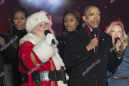 Us President Barack Obama (r) Sings Christmas Carols on Stage Beside Santa Claus (2-l) First Lady Michelle Obama (l) and Sasha Obama (c) During the 94th Annual National Christmas Tree Lighting on the Ellipse Near the White House in Washington Dc Usa 01 December 2016 the Lighting of the Tree is an Annual Tradition Attended by the Us President and the First Family President Calvin Coolidge Lit the First National Christmas Tree a 14 6 Meter High Balsam Fir in 1923 United States Washington