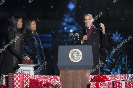 Us President Barack Obama (r) Delivers Remarks Moments Before Officially Lighting the National Christmas Tree with First Lady Michelle Obama (l) and Sasha Obama (2-l) on the Ellipse Near the White House (behind) in Washington Dc Usa 01 December 2016 the Lighting of the Tree is an Annual Tradition Attended by the Us President and the First Family President Calvin Coolidge Lit the First National Christmas Tree a 14 6 Meter High Balsam Fir in 1923 United States Washington
