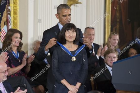 Stock Image of Us President Barack Obama (back) Awards Artist and Designer Maya Lin (front) the Presidential Medal of Freedom During a Ceremony in the East Room of the White House in Washington Dc Usa 22 November 2016 United States Washington