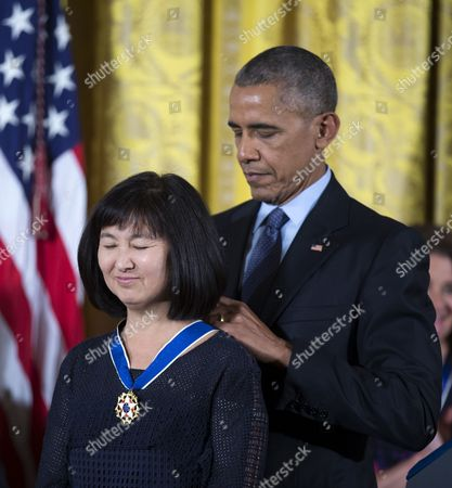 Stock Photo of Us President Barack Obama Awards Maya Lin (l) Designer of the Vietnam Veterans Memorial in Washington Dc the Presidential Medal of Freedom During a Ceremony in the East Room of the White House in Washington Dc Usa 22 November 2016 United States Washington