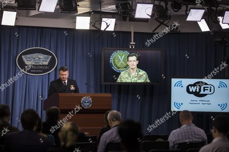 British Major General Rupert Jones Deputy Commander of Combined Joint Task Force Operation Inherent Resolve Speaks to the Media Via a Tv Monitor on the Operation's Developments While U S Navy Capt Jeff Davis (l) Looks on in the Pentagon Briefing Room at the Pentagon in Arlington Virginia Usa 30 November 2016 United States Arlington