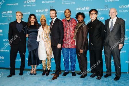 (l-r) British Actor Orlando Bloom Indian Actress Priyanka Chopra Beninois Singer Angelique Kidjo British Soccer Player and Unicef Goodwill Ambassador David Beckham Nigerian Musician Femi Kuti Sierra Leonean Author Ishmael Beah and Hong Kong Martial Artist Jackie Chan Attend the 70th Unicef Anniversary at the United Nations Headquarters in New York New York Usa 12 December 2016 Unicef Commemorates 70 Years of Work For Children with the Help of Some of the Organization's Best-known Goodwill Ambassadors and Celebrity Advocates United States New York