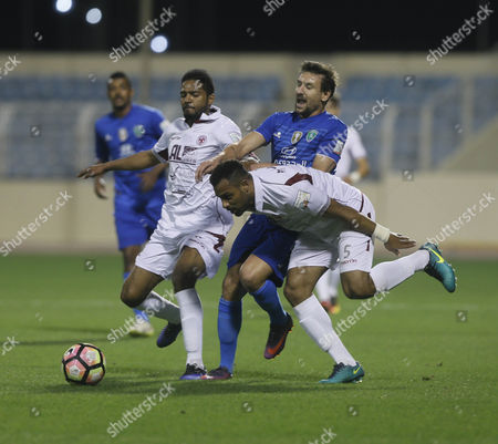 Al-Faisaly players Omar Abdulaziz (L) and Mohammed Salim (R) in action for the ball with Al-Fateh player Andre Felipe (C) during the Saudi Professional League soccer match between Al-Fateh and Al-Faisaly at Prince Abdullah bin Jalawi Stadium, Al-Hasa, Saudi Arabia, 27 January 2017.