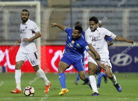 Al-Fateh player Nooh Al-Mossa (L) in action for the ball with Al-Faisaly player Omar Abdulaziz (R) during the Saudi Professional League soccer matchbetween Al-Fatehand Al-Faisalyat Prince Abdullah bin Jalawi Stadium, Al-Hasa, Saudi Arabia, 27 January 2017.