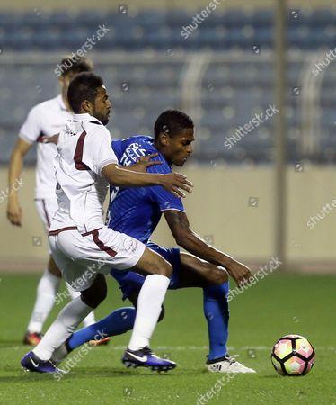 Al-Faisaly player Omar Abdulaziz (L) in action for the ball with Al-Fateh player Nathan (R) during the Saudi Professional League soccer match between Al-Fateh and Al-Faisaly at Prince Abdullah bin Jalawi Stadium, Al-Hasa, Saudi Arabia, 27 January 2017.