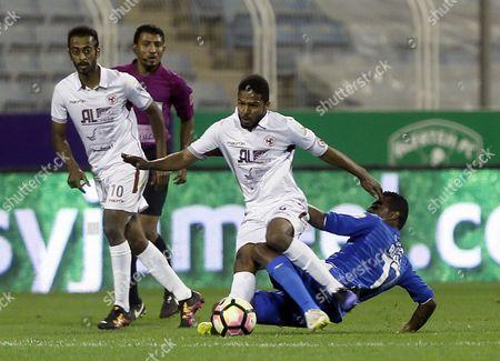 Al-Faisaly player Omar Abdulaziz (L) in action for the ball with Al-Faisaly player Riyadh Shrahili (R) during the Saudi Professional League soccer match between Al-Fateh and Al-Faisaly at Prince Abdullah bin Jalawi Stadium, Al-Hasa, Saudi Arabia, 27 January 2017.
