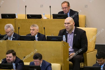 Valentina Tereshkova Russian lawmaker Nikolai Valuev, right, a former boxer, attends a plenary session in the State Duma, the lower house of the Russian parliament, in Moscow, Russia