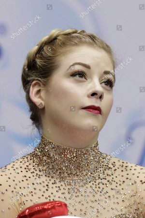Gracie Gold waits for her score during the women's free skate competition at the U.S. Figure Skating Championships, in Kansas City, Mo