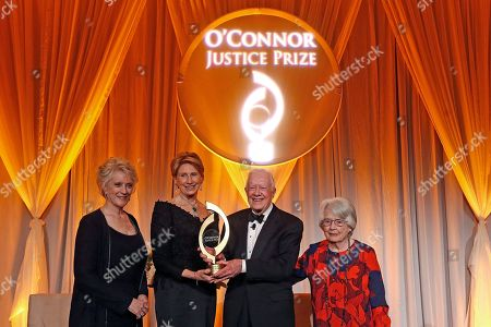 Stock Image of Former U.S. President Jimmy Carter, second from right, is flanked by former Chief Justice of the Arizona Supreme Court Ruth McGregor, left, former U.S. Ambassador to Finland Barbara Barrett, second from left, and former Chief Judge of the U.S. Court of Appeals Patricia Ward, right, as they pose for a photo he is honored by receiving the O'Connor Justice Prize at The Sandra Day O'Connor College of Law at Arizona State University Justice Prize Dinner, in Phoenix. The prize was established to raise visibility for rule of law initiatives and recognize people who have made extraordinary contributions to advancing rule of law, justice and human rights