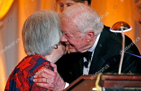 Stock Photo of Jimmy Carter, Patricia Wald Former President Jimmy Carter, right, smiles and embraces former Chief Judge of the U.S. Court of Appeals Patricia Wald, left, as Carter is honored by receiving the O'Connor Justice Prize at The Sandra Day O'Connor College of Law at Arizona State University Justice Prize Dinner, in Phoenix. The prize was established to raise visibility for rule of law initiatives and recognize people who have made extraordinary contributions to advancing rule of law, justice and human rights