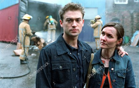 'Blue Dove'   TV  Twins Nick and Clare Weston (Paul Nicholls and Esther Hall) look on as firfighters extinguish the fire.