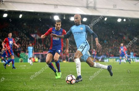 Fabian Delph of Manchester City and Mathieu Flamini of Crystal Palace  during the Emirates FA Cup 4th Round   match between Crystal Palace  and Manchester City   played at Selhurts Park   , London on  28th  January  2017