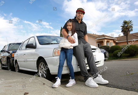 Aaron Cutchon, 35, poses with his step daughter, Nakyla Lindsey, 9, next to his car in Cordelia, Calif. Cutchon had his driver's license suspended after he was laid off from his job and was unable to keep up the payments on the nearly $2,000 in added fees and fines. State Sen. Robert Hertzberg, D-Van Nuys, has introduced a bill to ban the practice of suspending person's driver's licenses because they couldn't afford a traffic ticket