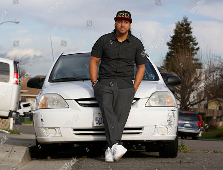 Aaron Cutchon, 35, poses next to his car in Cordelia, Calif. Cutchon had his driver's license suspended after he was laid off from his job and was unable to keep up the payments on the nearly $2,000 in added fees and fines. State Sen. Robert Hertzberg, D-Van Nuys, has introduced a bill to ban the practice of suspending person's driver's licenses because they couldn't afford a traffic ticket