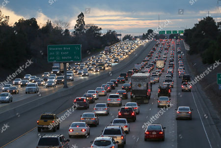 Evening rush hour traffic fills Highway 50 in Sacramento, Calif. State Sen. Robert Hertzberg, D-Van Nuys, has introduced a bill to ban the practice of suspending a person's driver's licenses because they couldn't afford to pay a traffic ticket
