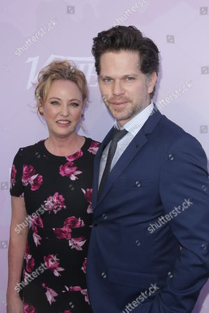 Stock Image of Virginia Madsen and Nick Holmes