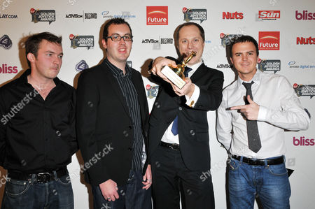Matt Littler (L) and Darren Jon Jeffries (R) from Hollyoaks attend the 26th Annual Golden Joystick Awards at the Hilton, London.   Pictured with winners of E4.com Grand Master Flash Award: Stickman Madness, Jodie Smith and Darius Bagdziunas (holding award).