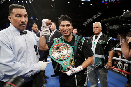 Stock Photo of Mikey Garcia, center, celebrates after defeating Dejan Zlaticanin, of Montenegro, during a lightweight title boxing match, in Las Vegas